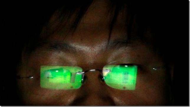 Hacker-Green-tint-spectacles-Reuters-720-624x351
